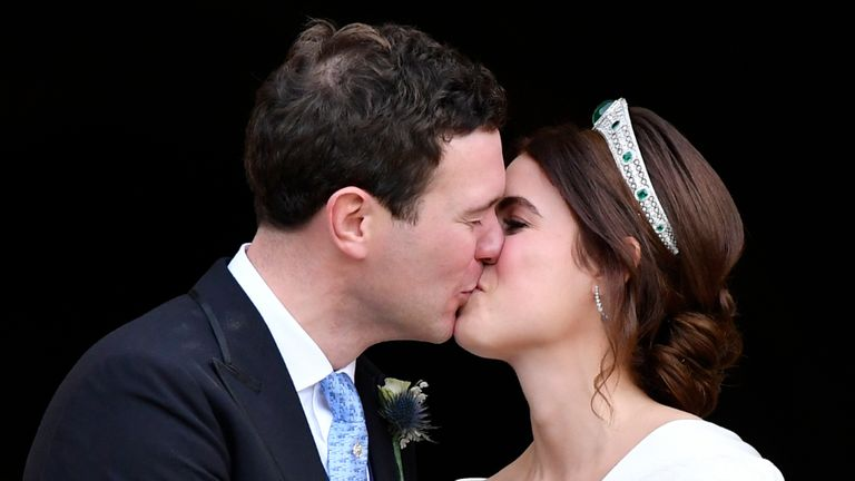 WINDSOR, ENGLAND - OCTOBER 12: Jack Brooksbank and Princess Eugenie of York share a kiss as they leave their wedding at St. George's Chapel on October 12, 2018 in Windsor, England.  (Photo by Toby Melville - WPA Pool/Getty Images)