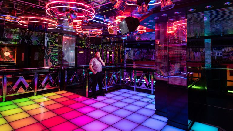 Gavin McQueen, the General Manager of Leeds PRYZM nightclub, poses for a photograph inside his nightclub in Leeds, central England on September 18, 2020, as it remains closed due to ongoing government restrictions on the nightclub sector to suppress the transmission of coronavirus. - The large capacity PRYZM nightclubs, of which there are 12 in the UK, are part of The Deltic Group - the UK's largest operator of late night bars and clubs. In the UK, nightclubs are one of the only class of entertainment venues that have not yet been allowed to reopen since the start of the coronavirus health crisis, and artists and (Photo by OLI SCARFF / AFP) / TO GO WITH AFP STORY BY VERONIQUE DUPONT (Photo by OLI SCARFF/AFP via Getty Images)