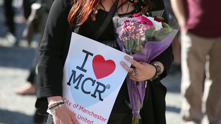 "File photo dated 23/05/17 of someone holding a sign at a vigil for the blast at the Manchester Arena. The mother of one of the victims has described how she had to ""switch the emotions off"" when she came face-to-face with one of the two brothers responsible for the massacre."