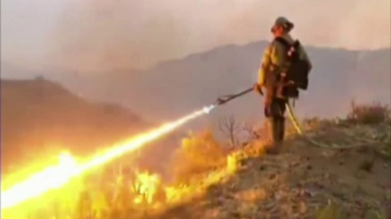Firefighters in California fight fire with fire by using a flamethrower.