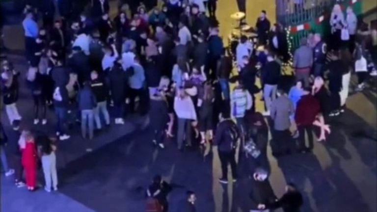 Londoners are seen partying on the street after 10pm pub curfew due to COVID restrictions.
