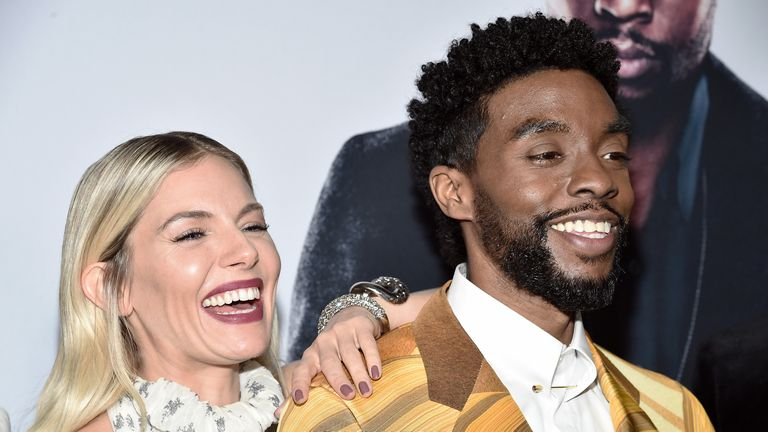 Sienna Miller and Chadwick Boseman ahead of the release of '21 Bridges'