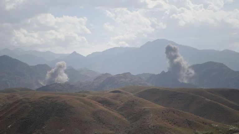 "In this photo taken on July 7, 2018, smoke rises after an air strike bomb on Islamic State (IS) militants positions in a checkpoint at the Deh Bala district in the eastern province of Nangarhar Province. - A US soldier was killed and two others wounded in an ""apparent insider attack"" in southern Afghanistan on July 8, NATO said, the first such killing in nearly a year. (Photo by WAKIL KOHSAR / AFP) (Photo credit should read WAKIL KOHSAR/AFP via Getty Images)"