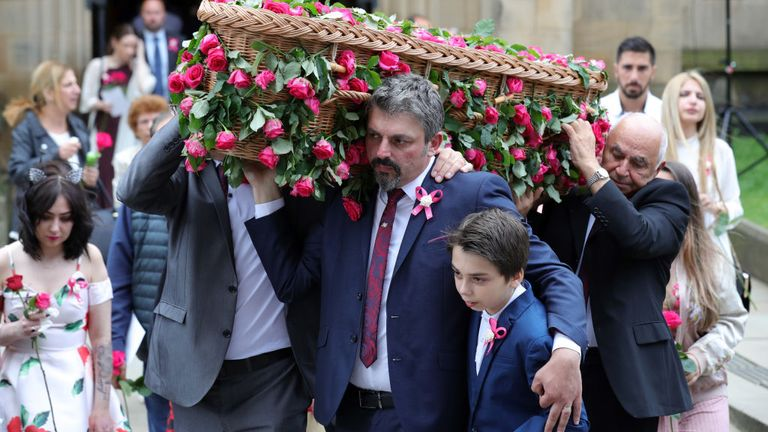 Andrew Roussos and his son Xander are seen carrying Saffie's coffin at her funeral in 2017