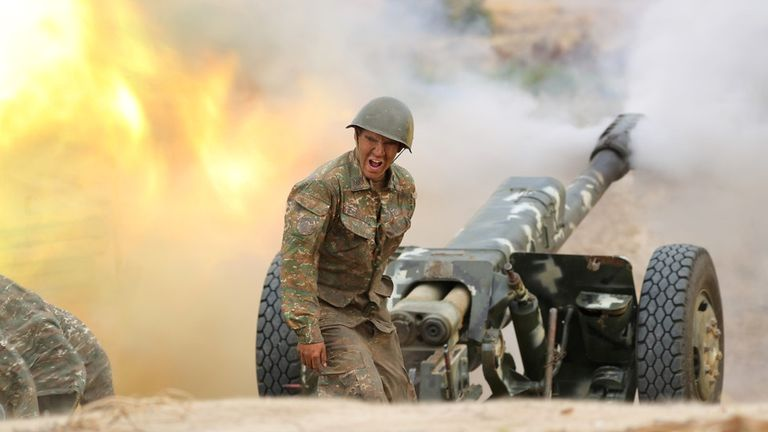 An ethnic Armenian soldier fires an artillery piece during fighting with Azerbaijan's forces in the breakaway region of Nagorno-Karabakh. Pic: Defence Ministry of Armenia/Reuters