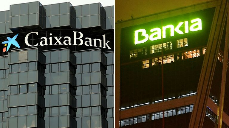 This combination of pictures created on September 4, 2020 shows Spanish bank Bankia's logo (TOP) and Spanish bank Caixabank -