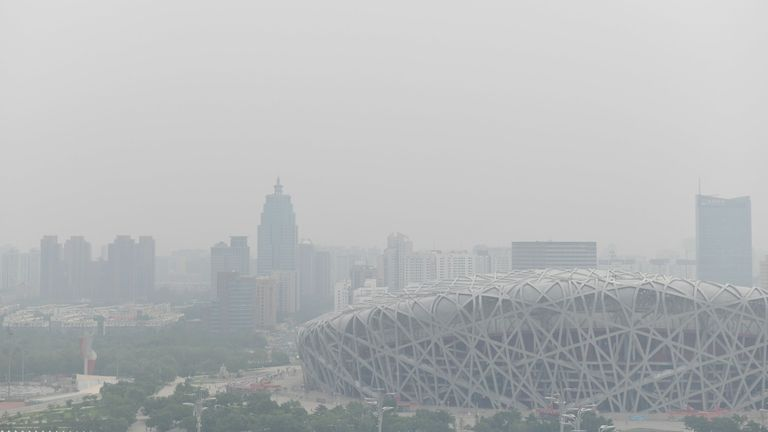 The National Stadium (lower R), known as the Bird's Nest and built for the 2008 Beijing Olympic Games, is pictured on a polluted day in Beijing on June 21, 2019