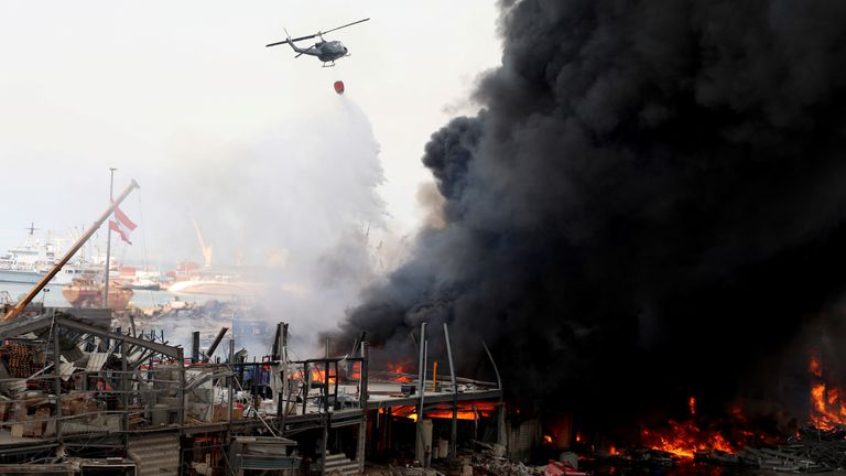A helicopter tries to put out a fire that broke out at Beirut's port area, Lebanon September 10, 2020. REUTERS/Mohamed Azakir