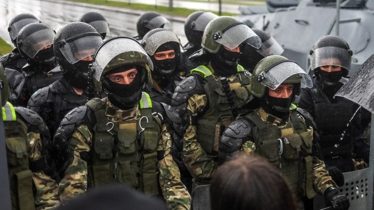 Riot police officers block a street during a rally on Sunday