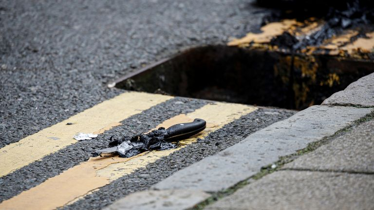 A knife lies on the pavement after being recovered by police from a drain following reported stabbings in Birmingham September 6, 2020 - it is not known if this is the weapon used