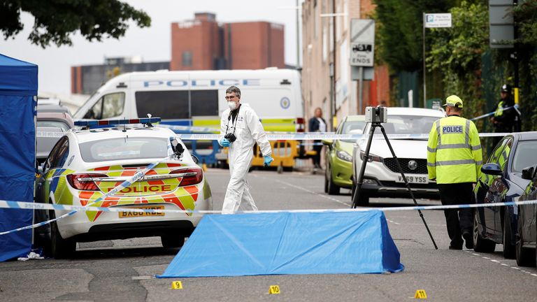 Police officers and a forensic worker are seen at the scene of reported stabbings in Birmingham, Britain, September 6, 2020