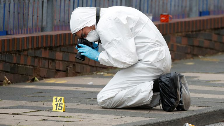 A forensic worker investigates at the scene of reported stabbings in Birmingham, Britain, September 6, 2020