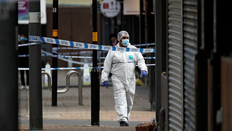 A forensic officer walks in the city centre after reported stabbings in Birmingham, Britain, September 6, 2020