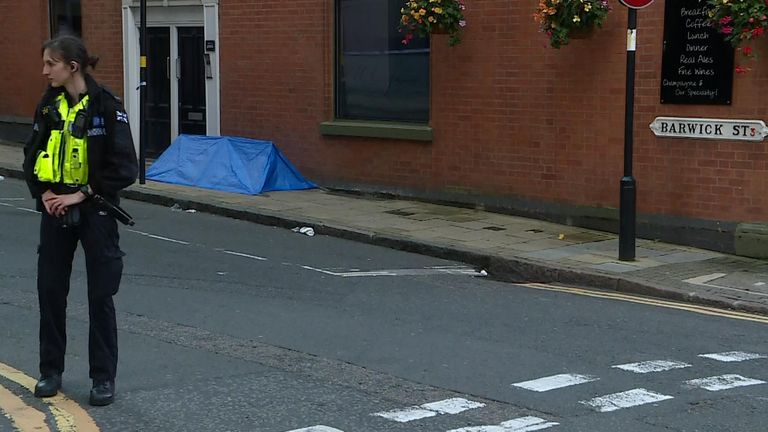 A body tent can be seen on Barwick Street in Birmingham city centre