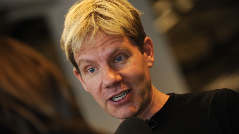 A file picture shows Danish professor Bjorn Lomborg as he speaks with a journalist at the Bella center of Copenhagen on December 15, 2009 on the 9th day of the COP15 UN Climate Change Conference. Humanity has what it takes to adapt to global warming and there's no need to panic: so goes the message in a new documentary on the bad boy of the climate change debate, Bjoern Lomborg. AFP PHOTO / ADRIAN DENNIS (Photo credit should read ADRIAN DENNIS/AFP via Getty Images)