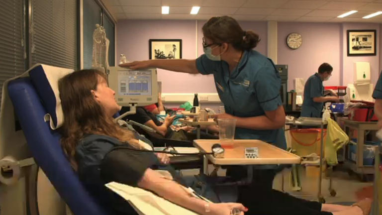 A woman donates blood plasma