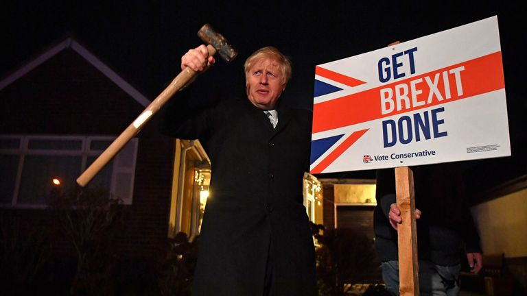 Boris Johnson with a 'Get Brexit Done' sign during the general election campaign