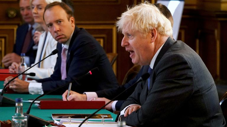 British Health Secretary Matt Hancock looks on as Prime Minister Boris Johnson speaks at a cabinet meeting at the Foreign Office in London, Britain September 15, 2020. Jonathan Buckmaster/Pool via REUTERS