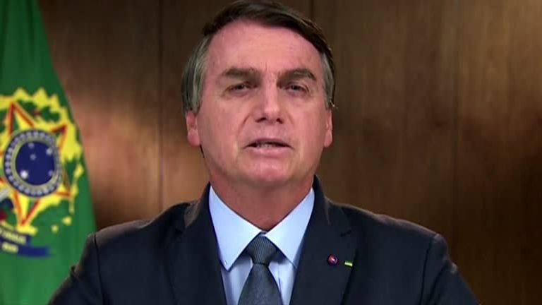 Brazilian leader Jair Bolsonaro defended his environmental record but denied fires were happening in his country
