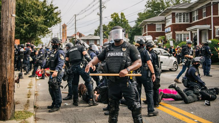 Police officers make arrests during protests on Wednesday