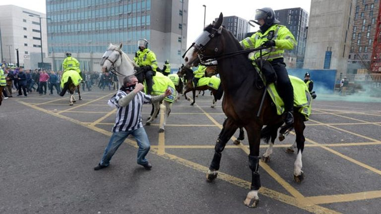 Bud the police horse is attacked by a Newcastle fan in April 2013. Pic: North News and Pictures.