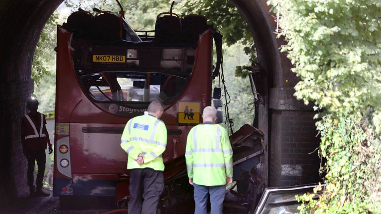 The scene on Well House Lane in Winchester after three children were taken to hospital with serious injuries while 13 others suffered minor injuries after the school bus they were travelling in crashed into a railway bridge.