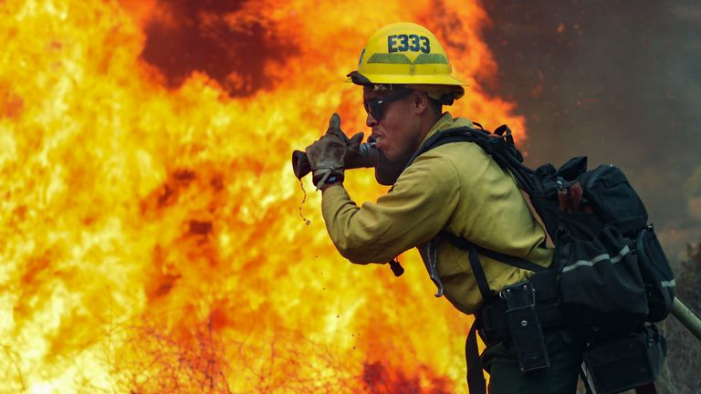 Firefighters battle part of the Valley Fire in Jamul, California