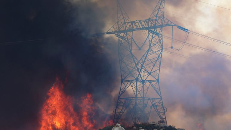 Power lines have been damaged by the wildfires, causing homes and businesses to lose power