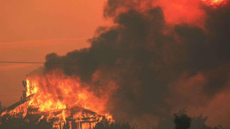 A home in Juniper Hills, California, burns during the Bobcat Fire on 18 September