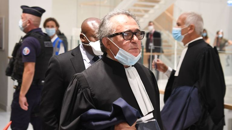A lawyer of one of the accused arrives at Paris' courthouse