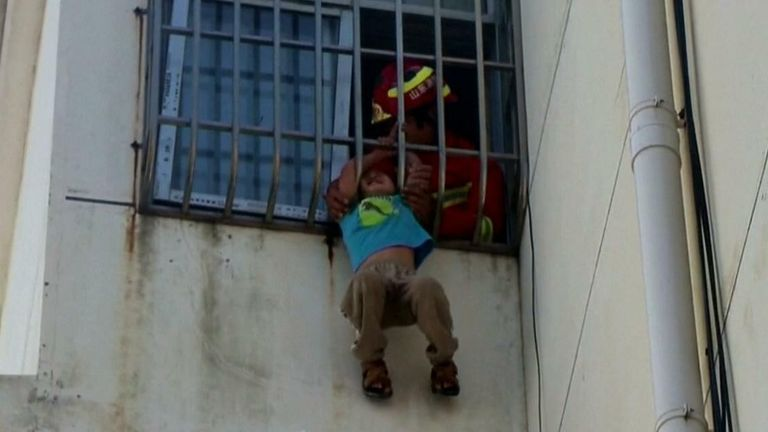 Six-year-old boy hanging from fifth story window rescued in China
