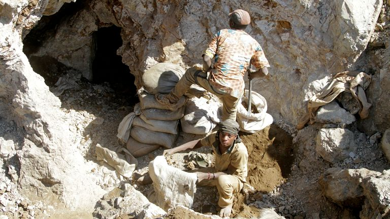 Workers are seen at a gold mine in the south of the Democratic of Congo in 2016