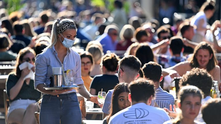 People sit at tables outside restaurants in Soho, amid the coronavirus disease (COVID-19) outbreak, in London, Britain, September 20, 2020. REUTERS/Henry Nicholls