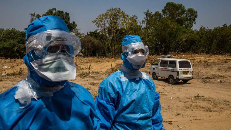 Indian health workers in hazmat suits