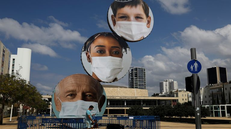 A statue in Tel Aviv, Israel, showing people wearing masks