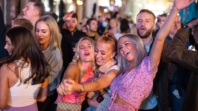 People gathered in London's West End over the weekend before the restrictions came into force