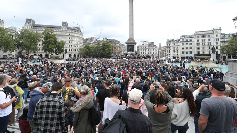 Anti-lockdown protesters, who believe that the coronavirus pandemic is a hoax, gather at the 'Unite For Freedom' rally in Trafalgar Square