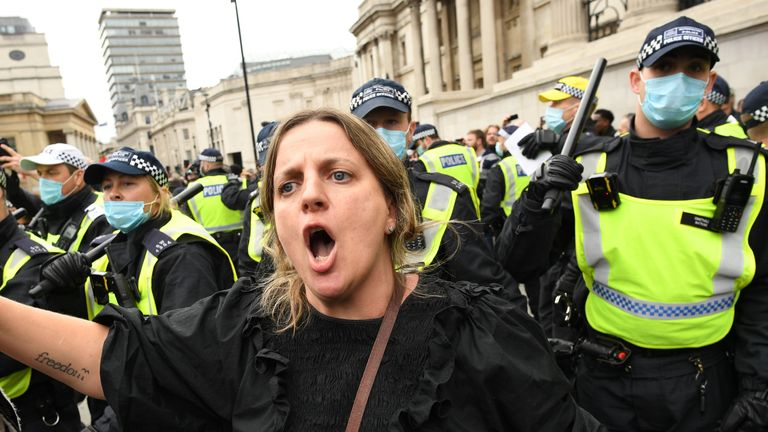 Protesters and police at a 'We Do Not Consent' rally at Trafalgar Square in London, organised by Stop New Normal, to protest against coronavirus restrictions.