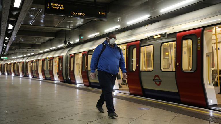 A man wearing a protective face mask is seen at Westminster tube station, following the outbreak of the coronavirus disease (COVID-19), London, Britain, May 11, 2020. REUTERS/Simon Dawson