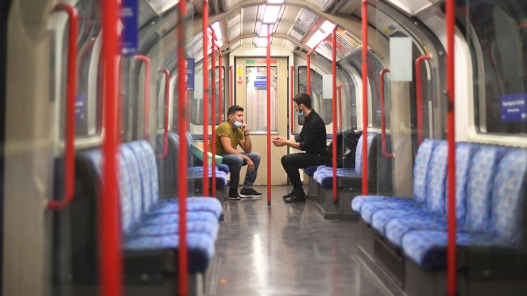 Passengers on a Central Line underground train, after a range of new restrictions to combat the rise in coronavirus cases came into place in England.
