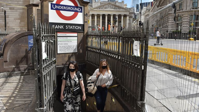 LONDON, ENGLAND - AUGUST 20: Women wearing a face masks exit Bank underground station on August 20, 2020 in London, England. Latest figures show a rise Covid-19 in a number of London boroughs with Richmond Upon Thames seeing a big jump. (Photo by John Keeble/Getty Images)