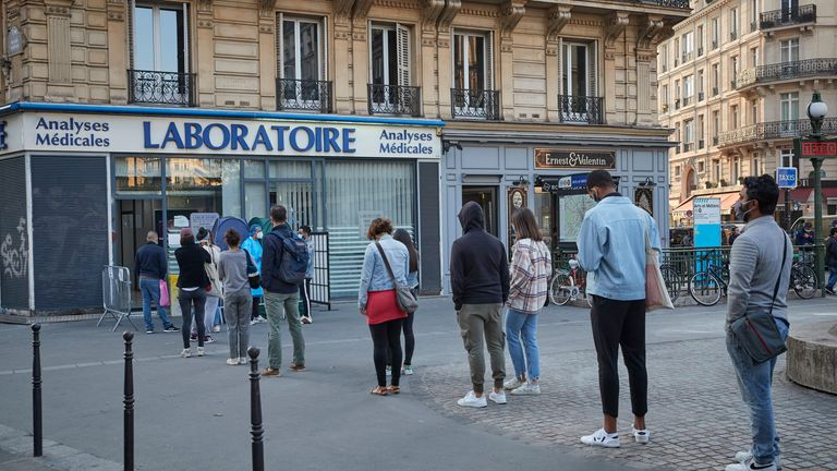 A queue for Covid-19 tests outside a laboratory in Paris