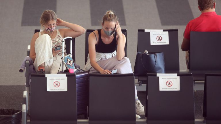 Holidaymakers are seen at an airport in Croatia last month after the country was added to the UK's quarantine list