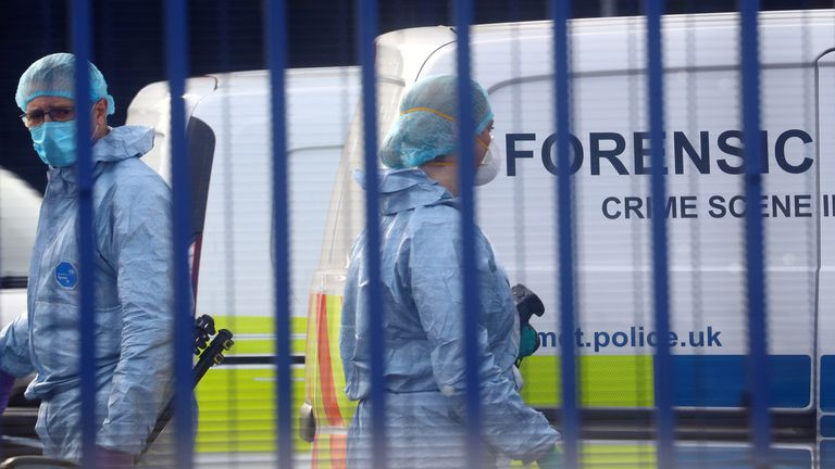 Forensic specialists are seen at the custody centre where a British police officer has been shot dead in Croydon, south London, Britain, September 25, 2020. REUTERS/Hannah McKay
