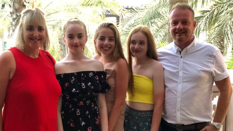 Darren Buttrick with his wife and three daughters