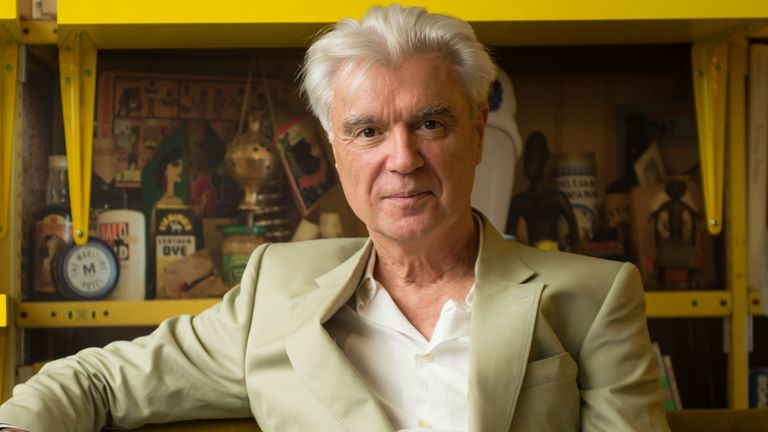 "David Byrne poses in the ""David Byrne Reading Lounge"" at the Meltdown Festival launch at Southbank Centre on August 17, 2015 in London, England"