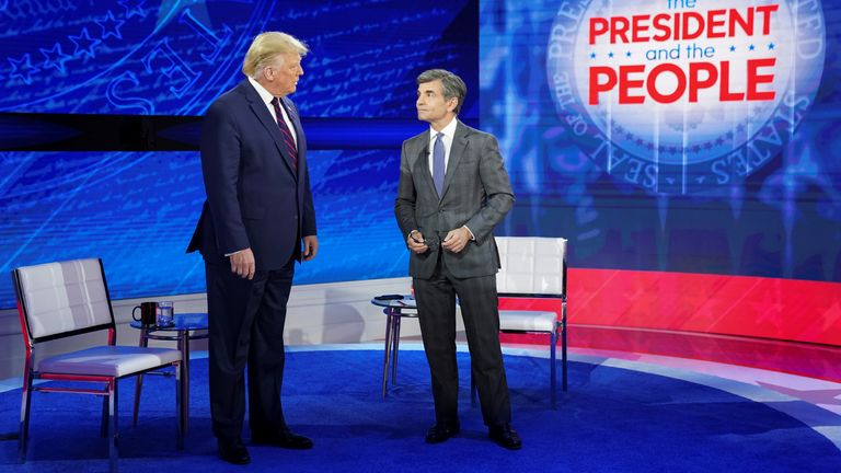Mr Trump takes the stage with ABC News host George Stephanopoulos