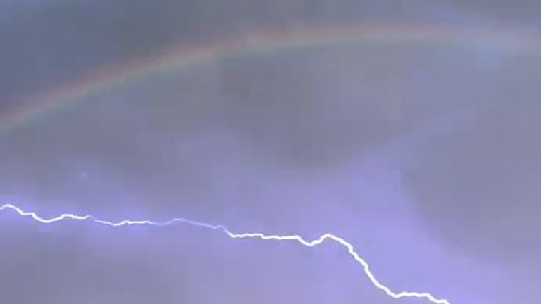 Double rainbow and lightning wows onlookers