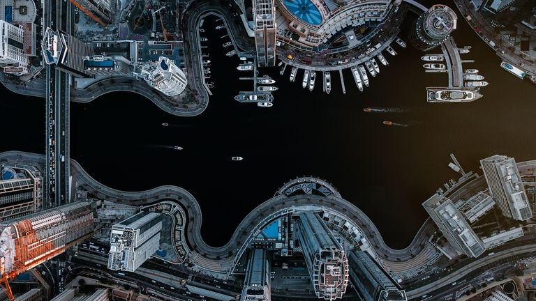 It is extraordinarily interesting to see the architectural designs of the buildings, the streets, and the pier of Dubai Marina that contrast with the ocean water