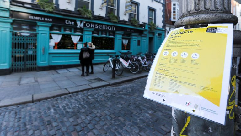 A notice about coronavirus is pictured as pub doors are locked in the Temple Bar area, as bars across Ireland close voluntarily to curb the spread of coronavirus, in Dublin, Ireland, March 15, 2020. REUTERS/Lorraine O'Sullivan